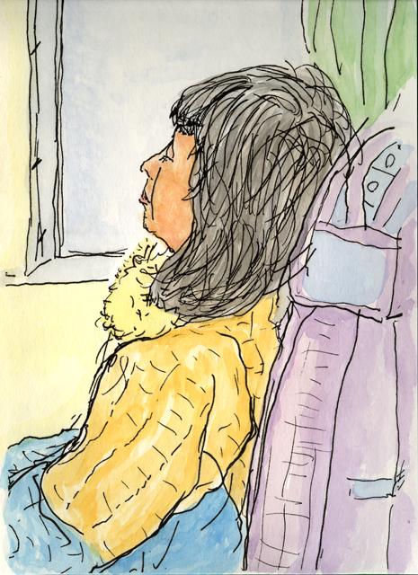 列車で眠る女