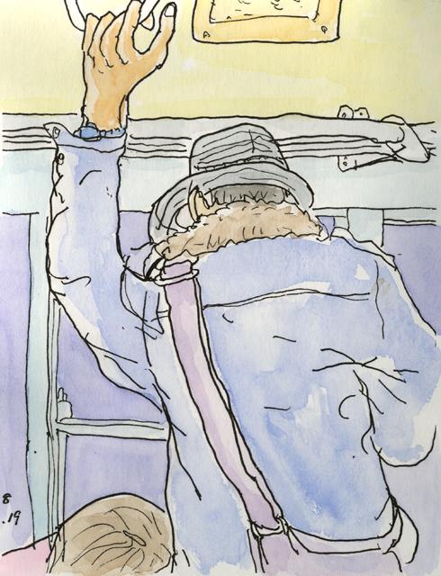 つり革の男