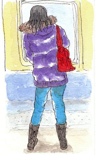 赤いバッグの女